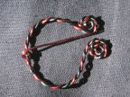 Home-made pennanular brooch from red and green wire